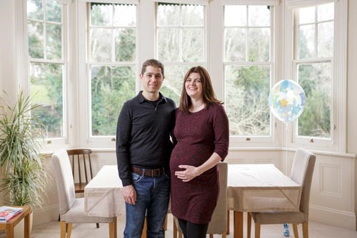 Emily and Nick stood in their home.