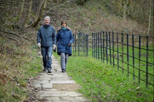 Andrew and Barbara walking down a country lane in the winter.