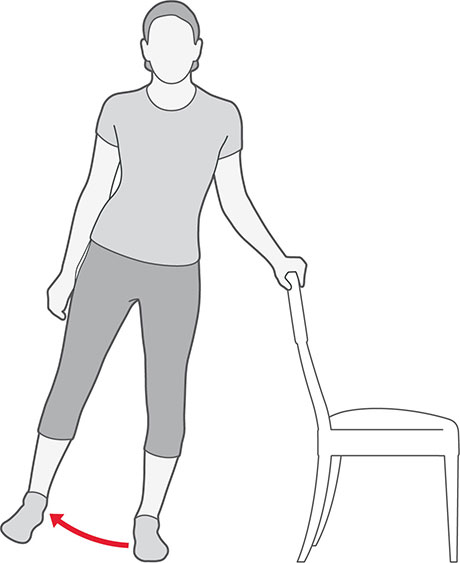 An illustration of someone standing and holding onto a chair, lifting their leg sideways.