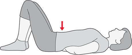 An illustration of someone laying on their back with their knees bent and hands under the small of their back. They're pulling their belly towards the floor.