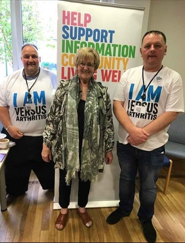 John McLester with colleagues promoting Versus Arthritis services