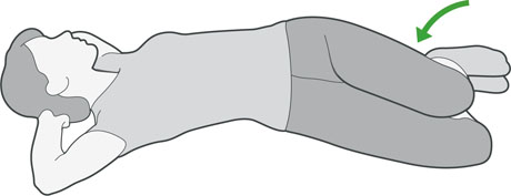 A diagram of someone lying on their back rolling their knees from side to side, which is an exercise to help with back pain.