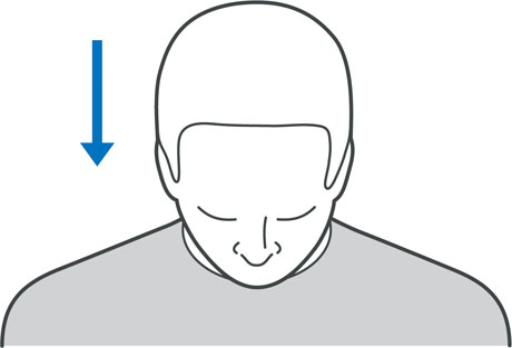 A diagram of someone tilting their head forward to stretch out the neck muscles.
