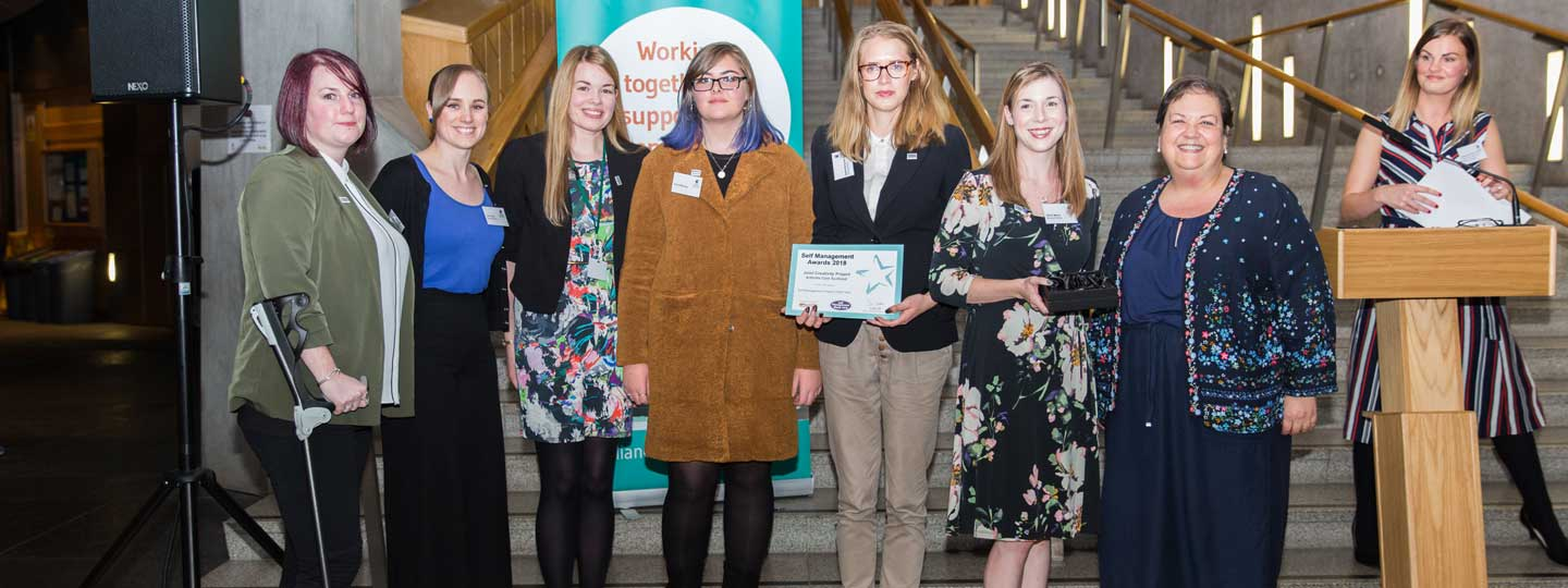 The Scotland Young People and Families service at the 2018 Self-Management awards at the Scottish Parliament.