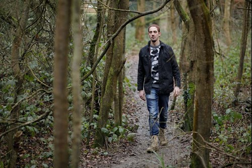Ben, who has ankylosing spondylitis, walking through the forest.