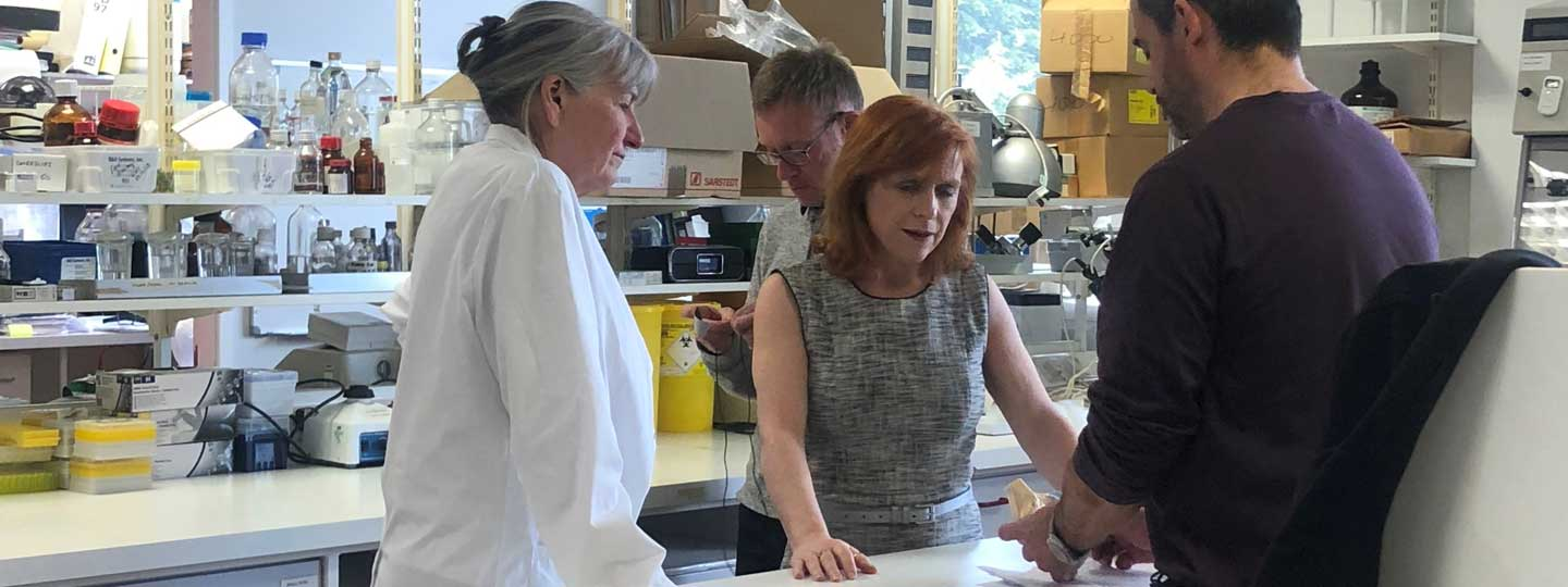 Sally Roberts in the lab with her colleagues.