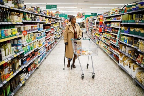 Monique in a supermarket shopping