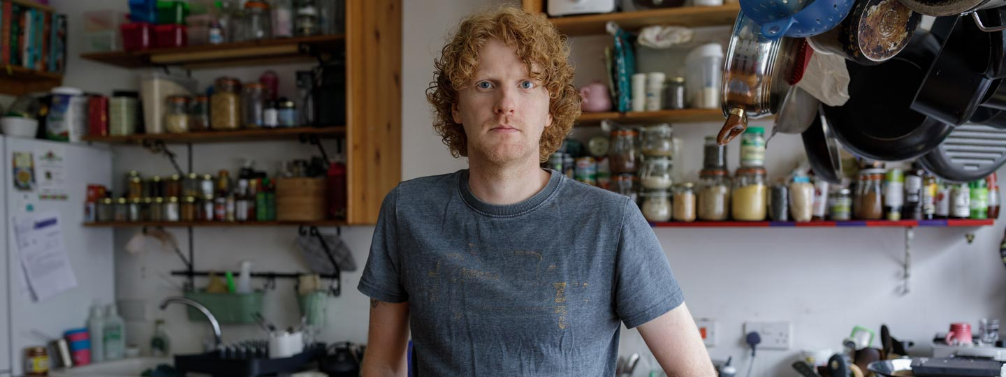 Dan stood next to a kitchen worktop in his home.