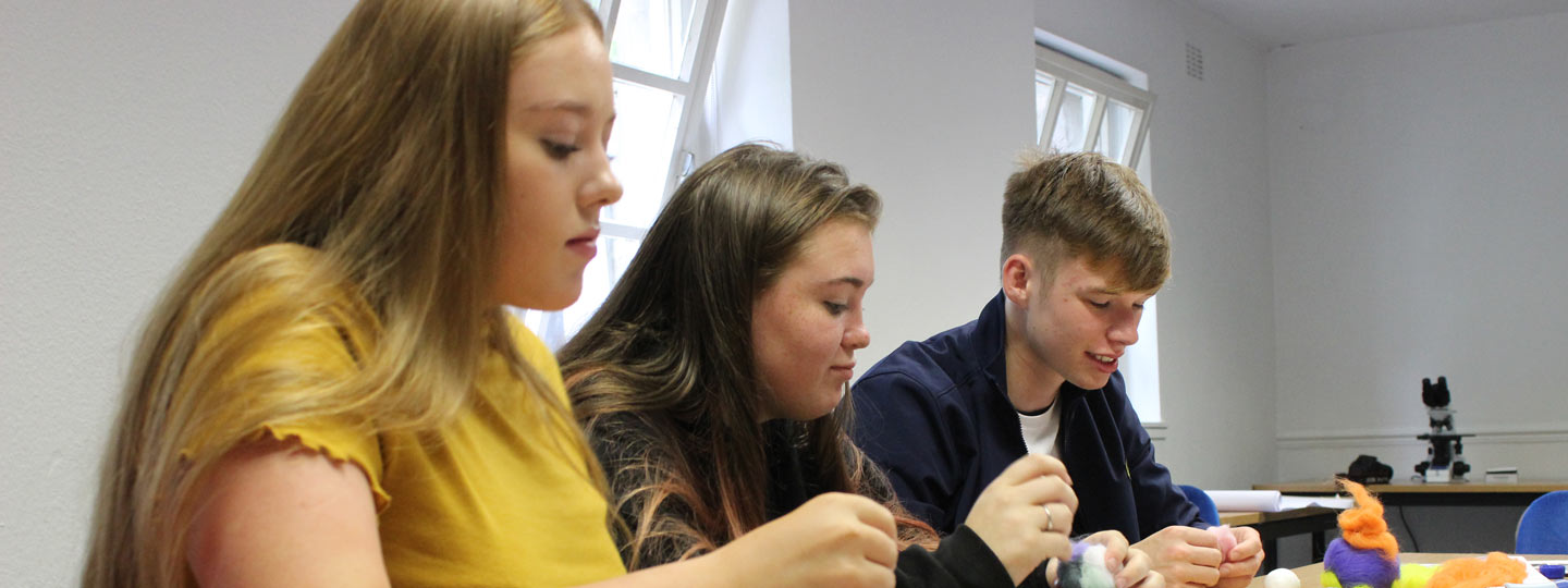 Cerys (on the left) and her friends at an arts workshop organised by Versus Arthritis.